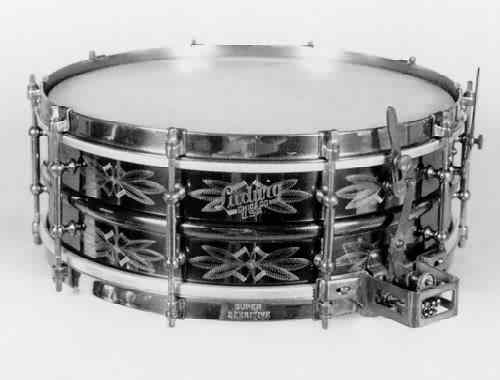 "LUDWIG: lue005s 5x14, 20's-30's, ""Black Beauty – Supersensitive"", flower-engraved heavyweight 2 pc. brass shell, 10 tube lugs, wires under both heads, brass finish hardware."