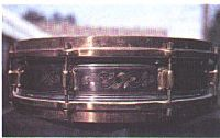 "A Leedy 4x14 ""Elite"" Professional snare drum, with gold/nickel-engraved shell, circa 1920"