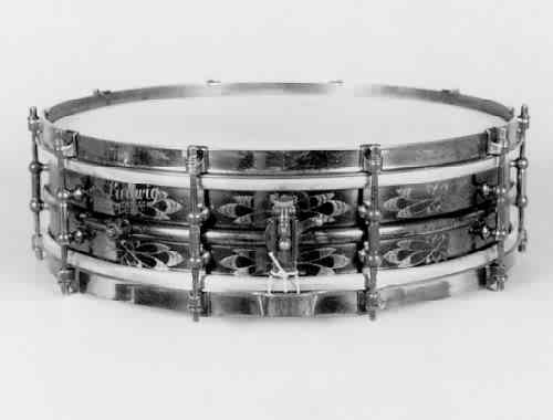 "LUDWIG:  lue002s  4x14, 20's-30's, piccolo, ""Black Beauty"", flower-engraved brass shell, 10 tube lugs,  brass finish hardware."