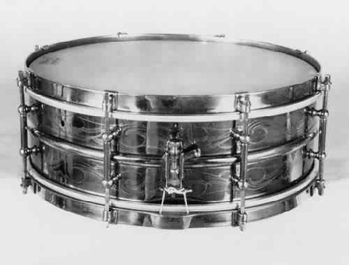 "LUDWIG:  lue006s  5x14, 20's, ""Black Beauty"", scroll-engraved heavyweight 2 pc. brass shell, 8 tube lugs, brass finish hardware."