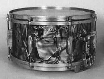 "LUDWIG:  luw002s  6½x14, circa '41, ""Standard"" model, black diamond pearl, 8 lugs, brass rims, 3 pt. strainer."