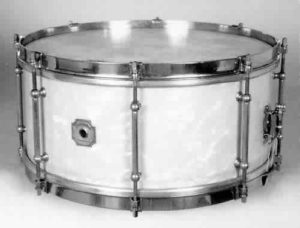 SHERWOOD:  shw000s  6½x14, '50-'55, made by Leedy/Ludwig, white marine pearl, 8 tube lugs, lip-style brass rims.